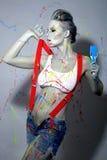 Weiblicher Anstreicher Splattered mit Latex-Farbe Lizenzfreie Stockfotografie