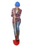 Weiblicher Arbeiter, der mit Schaufel gräbt Lizenzfreie Stockfotos