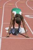 Weiblicher Athleten-Ready To Start-Rennen Stockfotos