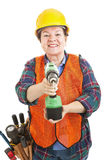 Weiblicher Bauarbeiter mit Bohrgerät Stockfoto