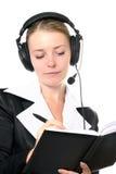 Weiblicher Bediener im Kopfhörer Stockfotos
