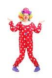 Weiblicher Clown, der mit den Händen gestikuliert Stockbilder