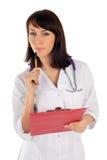 Weiblicher Doktor in der durchdachten Haltung Stockbild