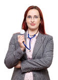 Weiblicher Doktor, der Stethoskop anhält Stockbild