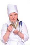 Weiblicher Doktor mit ihrem Geld stockbild