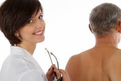 Weiblicher Doktor und Mann Stockbilder
