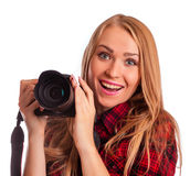 Weiblicher Fotograf, der eine Berufskamera - lokalisiertes ove hält Lizenzfreie Stockbilder