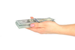 Weiblicher Handgriff 100 Dollar Banknoten lokalisiert auf einem weißen Hintergrund Abschluss oben Lizenzfreies Stockbild