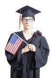 Weiblicher Junggeselle mit den Brillen, die amerikanische Flagge und Richter halten Lizenzfreie Stockfotos