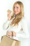 Weiblicher Käufer mit Kreditkarte Lizenzfreies Stockbild