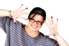 Weiblicher Künstler, der Spaß mit Lack hat Lizenzfreie Stockbilder