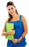 Weiblicher Kursteilnehmer mit Notizbüchern Lizenzfreies Stockbild