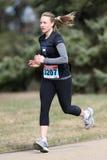 Weiblicher Marathon-Läufer Stockbilder