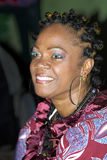 Weiblicher Musiker mit Senegal Stockfotografie