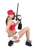 Weiblicher Paintballspieler stockbild