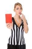Weiblicher Referent With Red Card und Pfeife Lizenzfreie Stockbilder