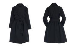 Weiblicher schwarzer Mantel Stockfoto