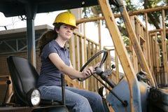 Weiblicher schwerer Ausrüstungs-Bediener lizenzfreies stockfoto