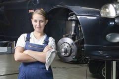 Weiblicher Selbstmechaniker ist erfüllt Stockfotografie