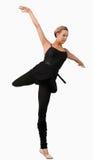 Weiblicher Tänzer, der auf einem Fuß steht Lizenzfreies Stockfoto