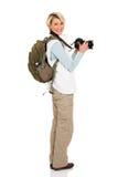 Weiblicher Tourist, der zurück schaut Stockfotografie