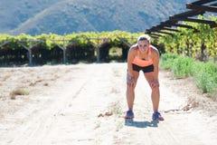 Weiblicher triathlete Betrieb lizenzfreie stockfotografie