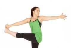 Weiblicher Yogalehrer in stehendem Torsionshaltung Parivrtta Hasta PA Stockfotos