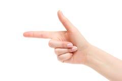 Weiblicher Zeigefinger auf einem weißen Hintergrund Stockbilder