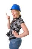 Weibliches Bauarbeiterblinzeln Stockfoto