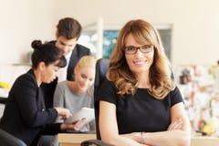 Weibliches Exekutivelächeln Lizenzfreies Stockfoto