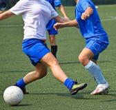 Weibliches Fußballspiel Stockfoto