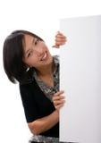 Weibliches Holdingleerzeichen-Weißzeichen Stockfoto