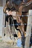 Weibliches Pferd Wrangler. Stockfoto