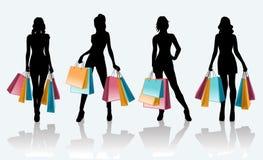 Weibliches schwarzes Schattenbild mit Einkaufstaschen Stockfotos