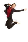 Weibliches Springen des schönen kaukasischen Geschäfts für mit Freude auf cel Stockfotos