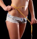 Weibliches Taillen- und Bandmaß Lizenzfreies Stockbild
