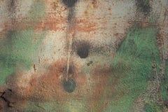 Weiche empfindliche Stellen des abstrakten Schmutzhintergrundes Farbvon Grünem und von Rotem auf der Beige Stockbild