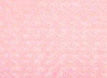Weiche rosafarbene Decke mit Rosen Stockfotografie