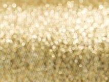 Weicher Fokushintergrund des abstrakten goldenen Funkelns Stockfoto