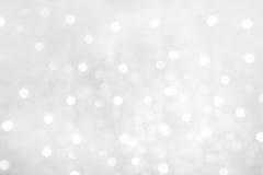 Weicher weißer Hintergrund mit bokeh Lichtern Stockfoto