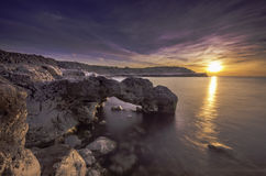 Weiches seidiges Wasser bei wunderbarem Sonnenuntergang Stockbild