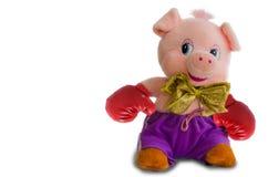 Weiches Spielzeugschwein auf einem weißen Hintergrund stockfotografie