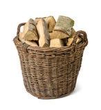 Weidenkorb gefüllt mit Holz Lizenzfreies Stockfoto