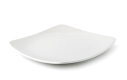 Weiße Platte auf weißem Hintergrund Stockfotografie