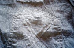 Weißes Gewinde Hintergrundder leinenhosen-Tasche Stockfotos