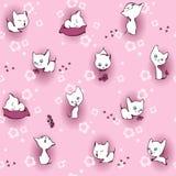 Weißes Kätzchen in den Blumen Lizenzfreie Stockfotos