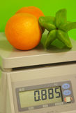 Weigh. Fruit in the supermaket Royalty Free Stock Photo