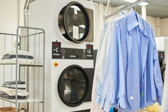 Weigh clean shirts on hangers. In the Laundry room Stock Images
