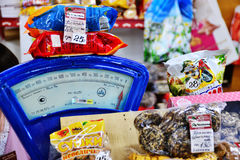 The    weigh-scales and sweets in the  market in the small russian town Royalty Free Stock Photos