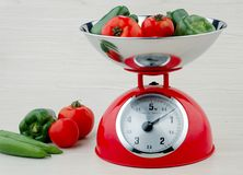 Weighing apparatus. There are some Vegetables on the weighing apparatus Stock Images